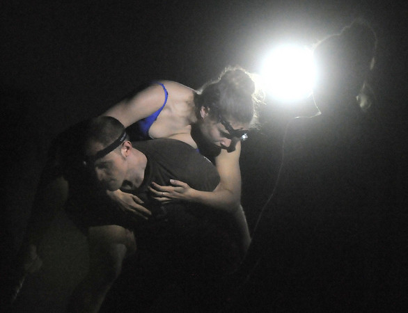 Elizabeth Towles and David Barbour dance in the light of headlamps during the rehearsal for the Rarities and Oddities performance at Ballet Nouveau Colorado on Thursday.<br /> <br /> March 31, 2011<br /> staff photo/David R. Jennings