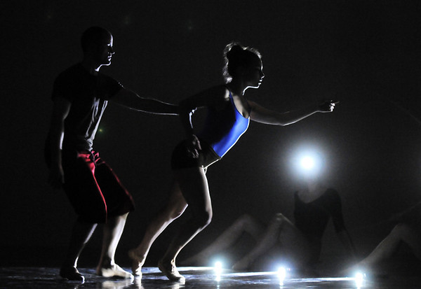 David Barbour and Elizabeth Towles dance in the light of other dancers headlamps during the rehearsal for the Rarities and Oddities performance at Ballet Nouveau Colorado on Thursday.<br /> <br /> March 31, 2011<br /> staff photo/David R. Jennings