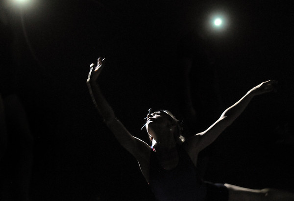 Sarah Tallman dances in the light of headlamps during the rehearsal for the Rarities and Oddities performance at Ballet Nouveau Colorado on Thursday.<br /> March 31, 2011<br /> staff photo/David R. Jennings