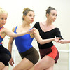 Sarah Tallman, left, Elizabeth Towles and Meredith Strathmeyer dance together during the rehearsal for the Rarities and Oddities performance at Ballet Nouveau Colorado on Thursday.<br /> <br /> March 31, 2011<br /> staff photo/David R. Jennings