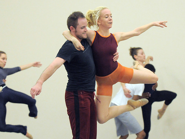 """Ballet Nouveau Colorado company dancers Sarah Tallman and David Barbour, center, rehearse at the BNC studios for the production of """"Carry On"""" which will be performed to live music of Paper Bird.<br /> <br /> January 14, 2011<br /> staff photo/David R. Jennings"""