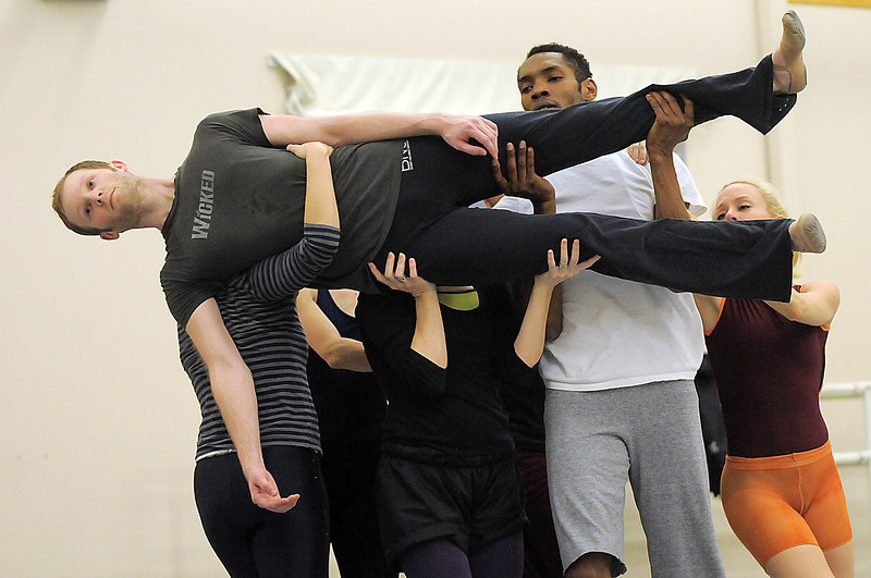 "Sean Watson is carried by Ballet Nouveau Colorado company members as they rehearse the production of ""Carry On"" at the BNC studios.  The dance company will be performing to live music by Paper Bird.<br /> <br /> January 14, 2011<br /> staff photo/David R. Jennings"
