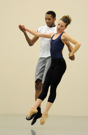 """Damien Patterson and Megan Coatney, Ballet Nouveau Colorado dancers, rehearse for the production of """"Carry On"""" at the BNC studios.  The dance company will be performing to live music by Paper Bird.<br /> <br /> January 14, 2011<br /> staff photo/David R. Jennings"""