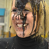 Mountain View Elementary School principal Tracey Amend is covered in a banana split topping of chocolate by students during an assembly at the school on Friday. <br /> November 30, 2012<br /> staff photo/ David R. Jennings