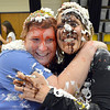 Mountain View Elementary School principal Tracey Amend, right, and assistant principal Shelley Stetler give eachother a hug after being covered in banana split toppings by students during an assembly at the school on Friday. <br /> <br /> November 30, 2012<br /> staff photo/ David R. Jennings