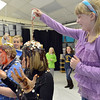 First grader Sammie Marietta, right, and kindergartener Mason Anderson pour candy sprinkles over the heads of Mountain View Elementary School principal Tracey Amend, right, and assistant principal Shelley Stetler  during an assembly at the school on Friday. The principals agreed to the stunt if 100 or more students ran in a fundraising event in October.<br /> <br /> November 30, 2012<br /> staff photo/ David R. Jennings