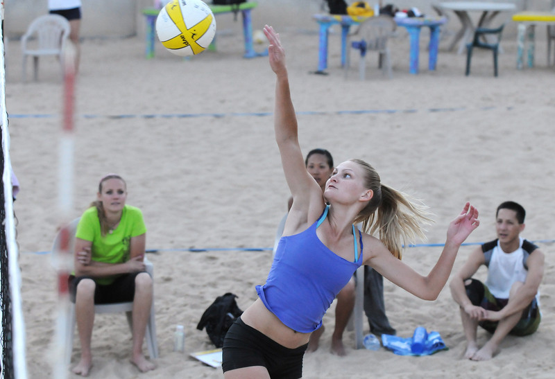 BE0701VOLLEY09<br /> Ashley Kaneta, Kelder-Kaneta team, moves to put the ball over the net during Wednesday's Barefoot pro circuit volleyball tryouts at Sports Oasis Volleyball.<br /> <br /> <br /> June 30, 2010<br /> Staff photo/ David R. Jennings