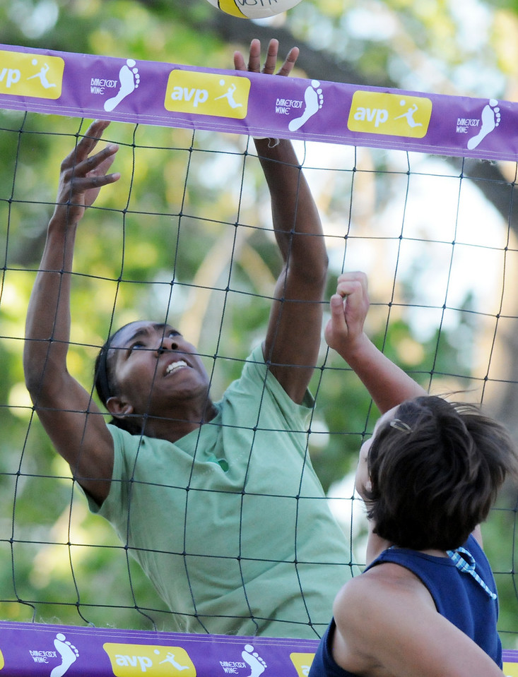 BE0701VOLLEY03<br /> Jenee Gilliam, left, Barkman-Gilliam team, blocks the ball from Andrea Hatcher, Hatcher-Lehman team,  during Wednesday's Barefoot pro circuit volleyball tryouts at Sports Oasis Volleyball.<br /> June 30, 2010<br /> Staff photo/ David R. Jennings