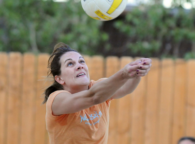 BE0701VOLLEY10<br /> Erin Lehman, Hatcher-Lehman team, sets the ball during Wednesday's Barefoot pro circuit volleyball tryouts at Sports Oasis Volleyball.<br /> <br /> <br /> June 30, 2010<br /> Staff photo/ David R. Jennings