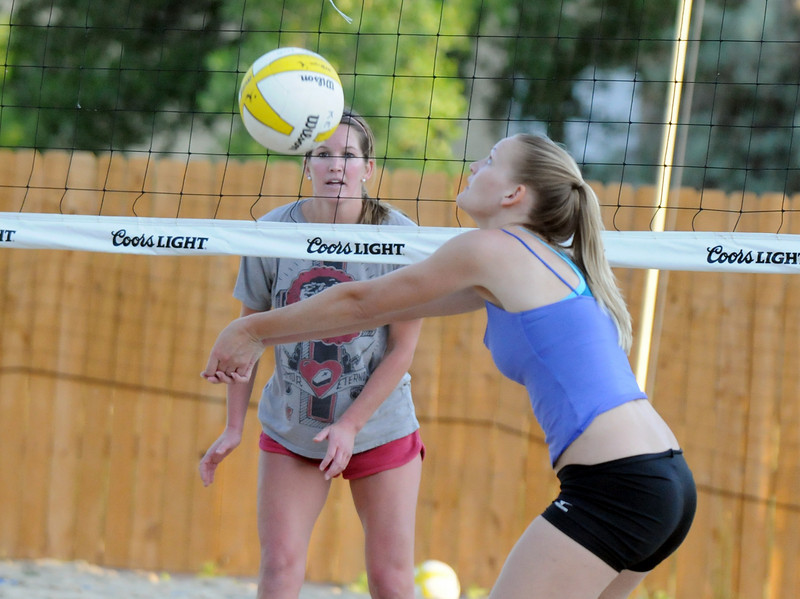 BE0701VOLLEY16<br /> Ashley Kaneta, right, sets the ball against Kaley Jorgensborg during Wednesday's Barefoot pro circuit volleyball tryouts at Sports Oasis Volleyball.<br /> <br /> <br /> June 30, 2010<br /> Staff photo/ David R. Jennings