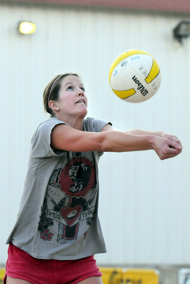 BE0701VOLLEY15<br /> Haley Jorgensborg sets the ball for teammate Amanda Wiggins during Wednesday's Barefoot Wine AVPNext Series volleyball tryouts for the pro circuit at Sports Oasis Volleyball.<br /> <br /> June 30, 2010<br /> Staff photo/ David R. Jennings