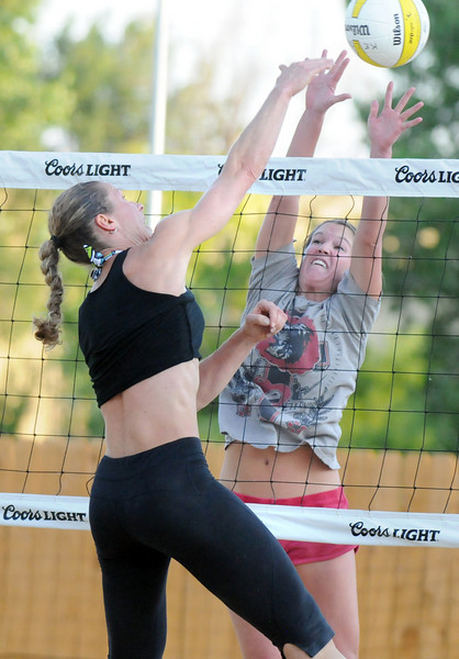 BE0701VOLLEY07<br /> Haley Jorgensborg, right, Jorgensborg-Wiggins team, blocks a spike by Jeanette Kelder, Kelder-Kaneta team, during Wednesday's Barefoot pro circuit volleyball tryouts at Sports Oasis Volleyball.<br /> <br /> June 30, 2010<br /> Staff photo/ David R. Jennings