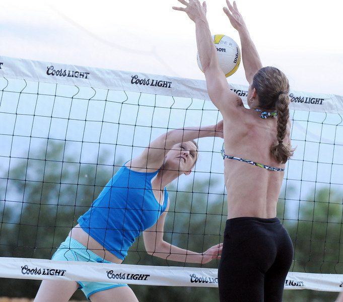 BE0708VOLLEY20<br /> Amanda Wiggins, left, spikes the ball but is blocked by Jeanette Kelder during Wednesday's Barefoot pro circuit volleyball tryouts at Sports Oasis Volleyball.<br /> <br /> July 2, 2010<br /> Staff photo/ David R. Jennings