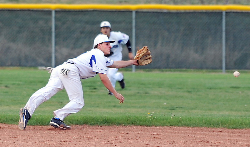 Jordan Arensdorf, Broomfield, runs to try and catch the ball hit by Silver Creek during Thursday's game at Broomfield High School.<br /> <br /> May 03, 2012 <br /> staff photo/ David R. Jennings
