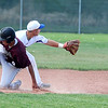 Angelo Perez, Broomfield, waits for the ball as Trey fleming, Silver Creek, slides to second base during Thursday's game at Broomfield High School.<br /> <br /> May 03, 2012 <br /> staff photo/ David R. Jennings