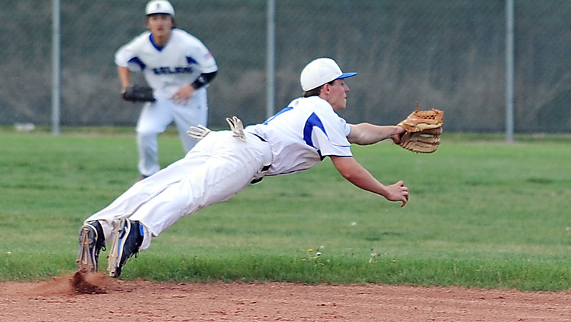 Jordan Arensdorf, Broomfield, dives for the ball hit by Silver Creek during Thursday's game at Broomfield High School.<br /> <br /> May 03, 2012 <br /> staff photo/ David R. Jennings