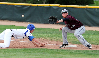 Jackson Lockwood, Broomfield, dives safely back to first base against  Wyatt Knechtel, Silver Creek, during Thursday's game at Broomfield High School.  May 03, 2012  staff photo/ David R. Jennings