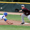 Jackson Lockwood, Broomfield, dives safely back to first base against  Wyatt Knechtel, Silver Creek, during Thursday's game at Broomfield High School.<br /> <br /> May 03, 2012 <br /> staff photo/ David R. Jennings