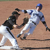 Broomfield's Parker Oliver slides to 3rd base against Thompson Valley's Quaid Moore during Thursday's game at Broomfield.<br /> March 22, 2012 <br /> staff photo/ David R. Jennings