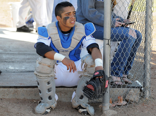 Catcher Ben Martinez, Broomfield, waits in the dugout during Thursday's game against Thompson Valley at Broomfield.<br /> March 22, 2012 <br /> staff photo/ David R. Jennings