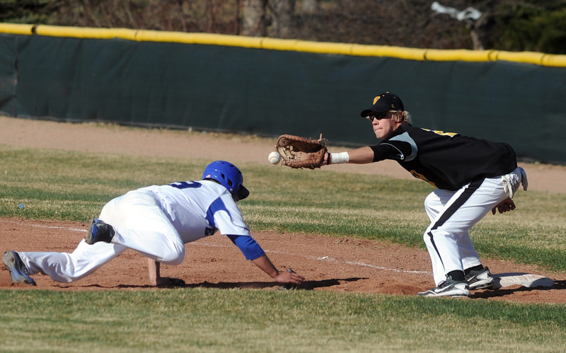 Broomfield's Angelo Perez slides back to 1st base against Thompson Valley's Jeremy White during Thursday's game at Broomfield.<br /> March 22, 2012 <br /> staff photo/ David R. Jennings