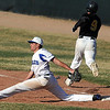Broomfield's first baseman Dylan Gable, forces out Thompson Valley's Kyle Kelly during Thursday's game at Broomfield.<br /> March 22, 2012 <br /> staff photo/ David R. Jennings