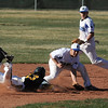 Broomfield's Angelo Perez catch's the ball as Thompson Valley's Trevor Yep slides to 2nd base during Thursday's game at Broomfield.<br /> March 22, 2012 <br /> staff photo/ David R. Jennings