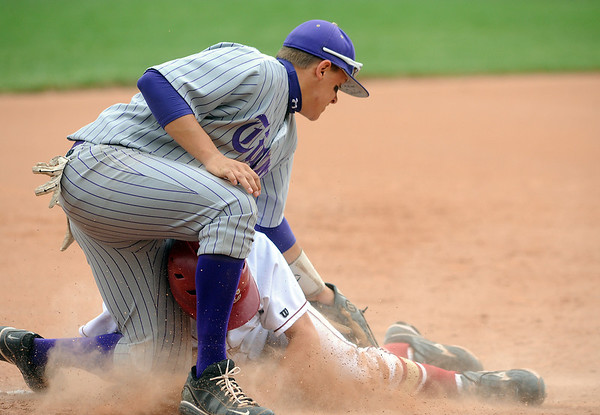 Holy Family's Zach Dedin tags out  Faith Christian's Colby Smith at third during Saturday's game at Faith Christian.<br /> <br /> April 14, 2012 <br /> staff photo/ David R. Jennings