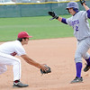 Holy Family's Joe Walls tries to avoid Faith Christian's Isaac Henry  while running to third base during Saturday's game at Faith Christian.<br /> <br /> April 14, 2012 <br /> staff photo/ David R. Jennings