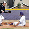 Holy Family's Jarred DeHerrrera sldes safley to second base against Jefferson Academy's Jake Barlow during Saturday's game at Holy Family.<br /> March 24, 2012 <br /> staff photo/ David R. Jennings