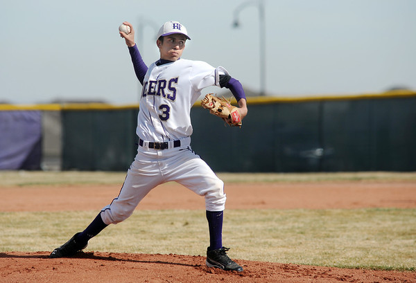 Holy Family's Louis Simpson pitches against Jefferson Academy during Saturday's game at Holy Family.<br /> March 24, 2012 <br /> staff photo/ David R. Jennings