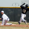 Holy Family's Garret West catches the ball at first base forcing out Jefferson Academy's Jake Barlow during Saturday's game at Holy Family.<br /> March 24, 2012 <br /> staff photo/ David R. Jennings