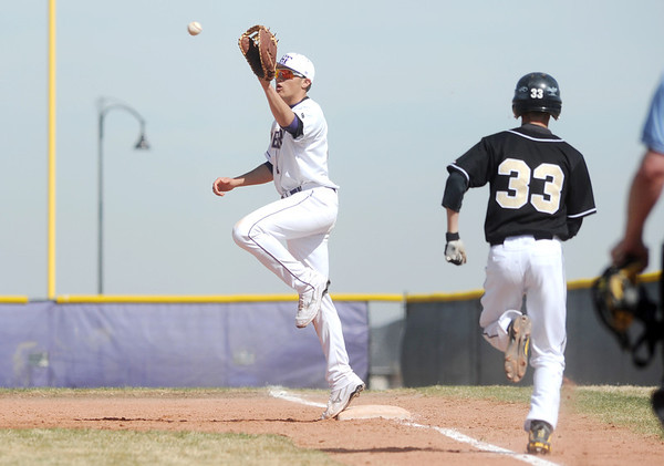 Holy Family's first baseman Garrett West catches the ball forcing out  Jefferson Academy's #33 during Saturday's game at Holy Family.<br /> March 24, 2012 <br /> staff photo/ David R. Jennings