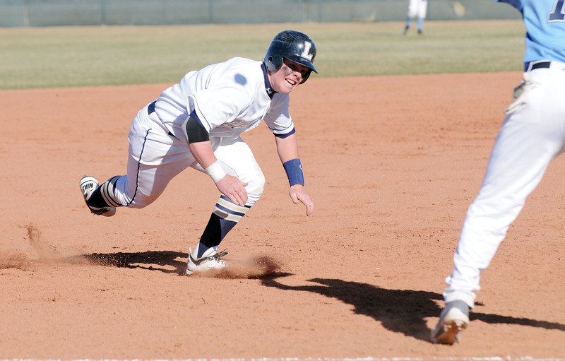Legacy's Ty Overboe slides to 3rd base but was tagged out by  Ralston Valley's Trae Russell during Friday's game at Legacy.<br /> March 23, 2012 <br /> staff photo/ David R. Jennings