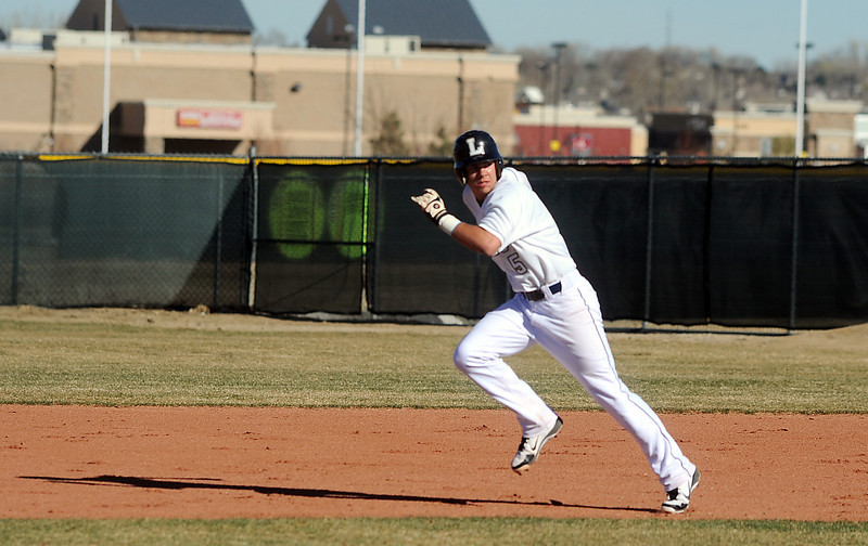 Legacy's Dylan Farrell runs to second base against Ralston Valley during Friday's game at Legacy.<br /> March 23, 2012 <br /> staff photo/ David R. Jennings