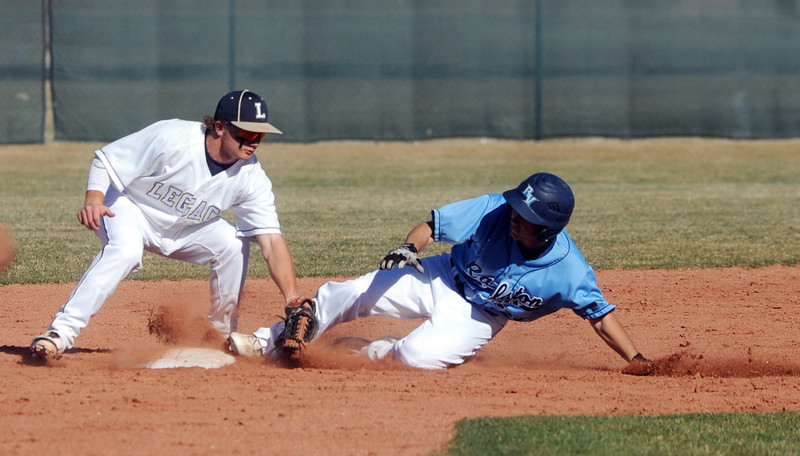 Legacy's Dillon Bolig tags out Ralston Valley's Kai Stalker at second base during Friday's game at Legacy.<br /> March 23, 2012 <br /> staff photo/ David R. Jennings