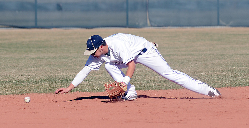 Legacy's Dylan Farrell chases after the ball hit by Ralston Valley during Friday's game at Legacy.<br /> March 23, 2012 <br /> staff photo/ David R. Jennings