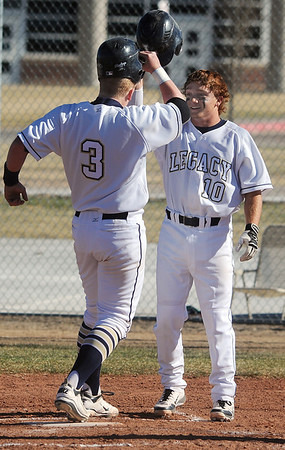 Legacy's Ty Overboe, left, celebrates scoring a run against Ralston Valley with Dillon Bolig during Friday's game at Legacy.<br /> March 23, 2012 <br /> staff photo/ David R. Jennings