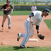 Legacy's third baseman Daniel Lee  catches the ball as Rocky Mountain's Cale O'Donnell runs to third base during Saturday's game at Legacy.<br /> <br /> April 28, 2012 <br /> staff photo/ David R. Jennings