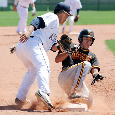 Legacy's Daniel Lee tags Rocky Mountain's Nick Komar  out at third base during Saturday's game at Legacy.<br /> <br /> April 28, 2012 <br /> staff photo/ David R. Jennings