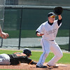 Legacy's Drew Wells nearly forces Rocky Mountain's Marcus Bean out at first base during Saturday's game at Legacy.<br /> <br /> April 28, 2012 <br /> staff photo/ David R. Jennings