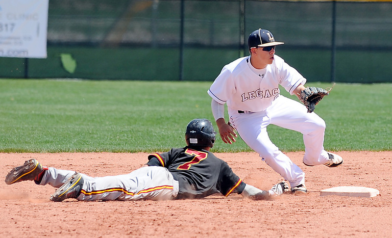 Legacy's Dillon Bollig tries to tag out Rocky Mountain's Cale O'Donnell at second base during Saturday's game at Legacy.<br /> <br /> April 28, 2012 <br /> staff photo/ David R. Jennings