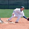 Legacy's Dillon Bolligcatches the ball at second base while Rocky Mountain's Casey Madigan slides during Saturday's game at Legacy.<br /> <br /> April 28, 2012 <br /> staff photo/ David R. Jennings