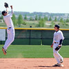 Legacy's Dylan Farrell jumps up to catch the ball at second base with Dillon Bollig during Saturday's game against Rocky Mountain at Legacy.<br /> <br /> April 28, 2012 <br /> staff photo/ David R. Jennings
