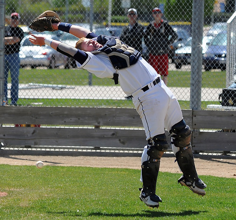 Legacy's catcher Ty Overboe reachs to try and catch a foul ball hit by a Rocky Mountain player during Saturday's game at Legacy.<br /> <br /> April 28, 2012 <br /> staff photo/ David R. Jennings