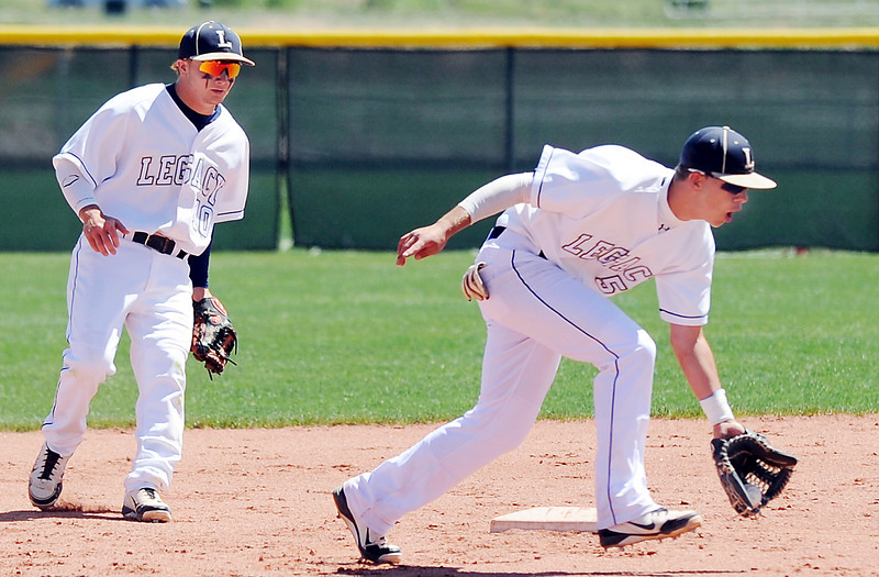Legacy's Dylan Farrell scoops up a ground ball near second base hit by Rocky Mountain during Saturday's game at Legacy.<br /> <br /> April 28, 2012 <br /> staff photo/ David R. Jennings