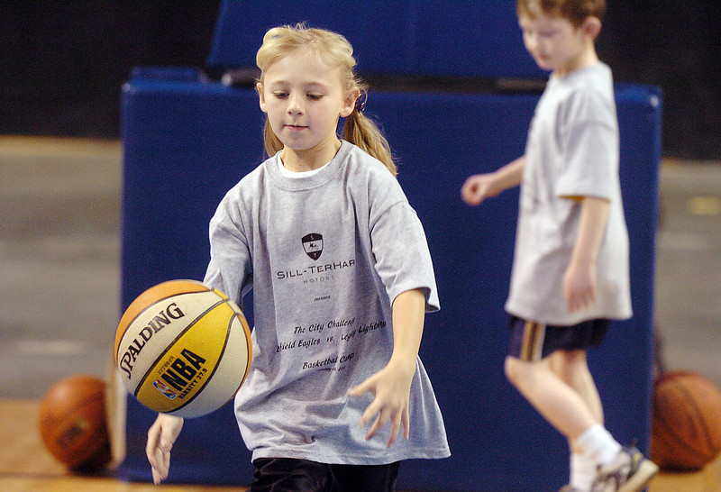 Kara Zila, 9, dribbles the ball down court during the basketball clinic before Saturday's Broomfield  Vs. Legacy girls and boys games at the 1stBank Center.<br /> January 8, 2011<br /> staff photo/David R. Jennings