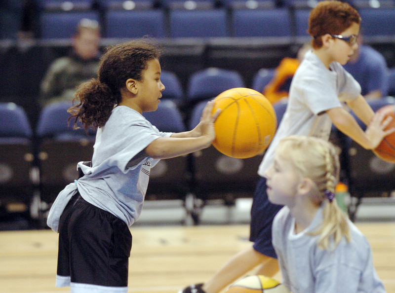 Alyssa Remy, 8, works on dribbling the ball during the basketball clinic before Saturday's Broomfield  Vs. Legacy girls and boys games at the 1stBank Center.<br /> January 8, 2011<br /> staff photo/David R. Jennings