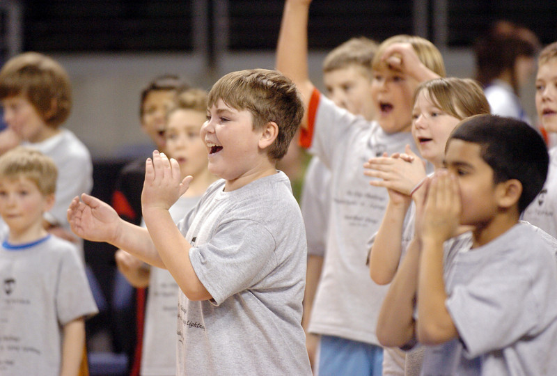Dimitri Easton, 10 cheers with fellow students as they watch a contest of shooting baskets with Broomfield High and Legacy High players during the basketball clinic before Saturday's Broomfield  Vs. Legacy girls and boys games at the 1stBank Center.<br /> January 8, 2011<br /> staff photo/David R. Jennings