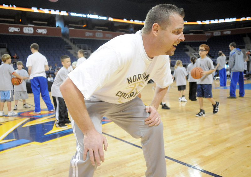 Legacy High coach Gunnar Johnson watches participants in defense drills during the basketball clinic before Saturday's Broomfield  Vs. Legacy girls and boys games at the 1stBank Center.<br /> January 8, 2011<br /> staff photo/David R. Jennings